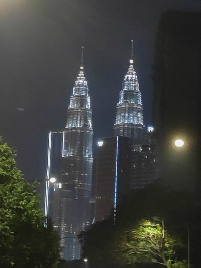 Fully lit up Petronas twin towers at night!